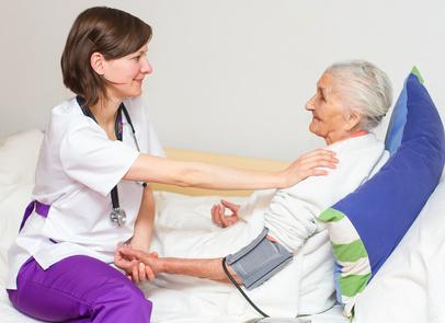Happy joyful nurse caring for  an elderly woman  helping her days in nursing home.